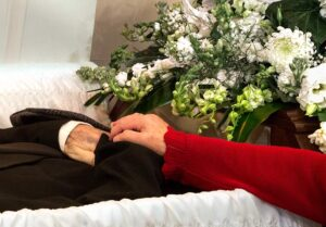 funeral scene wife touching husband for last time