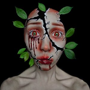 woman broken face crying tears of blood with leaves growing from her face